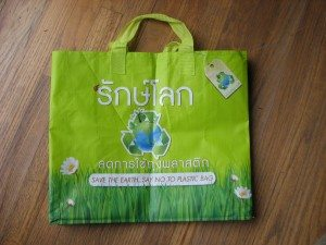 "A re-usable Thai bag with the slogan ""Save the Earth.  Say No to Plastic Bags"""